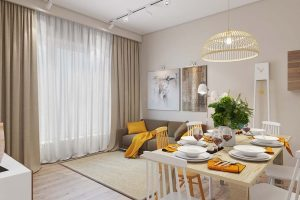 Voici comment creer une salle de sejour chic et moderne dans votre appartement. Avec des rideaux voilages pour habiller les fenêtres, une jette pour le divan et quelques coussins.